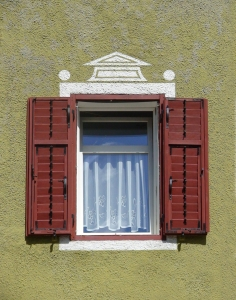 window-in-the-facade-of-dolomite-house-1383066-m